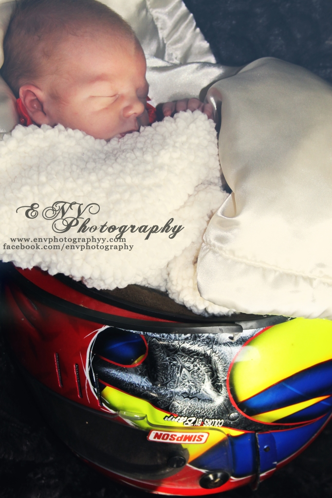 Uncle Chase has racing in his blood and wanted so badly for his brand new nephew to have his picture taken in his helmet.
